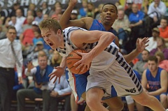 SPOKESMAN PHOTO: COREY BUCHANAN - Wilsonville senior Zach Reichle drives baseline during the state title game against Churchill.