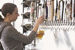 (Image is Clickable Link) JAIME VALDEZ - Teresa Purkiss is just one of several employees that make it their specialty to help customers with their favorite craft beer or wine at The