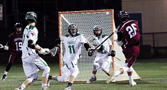 DAN BROOD - Sherwood senior Jordan Craig (26) fires a shot toward the Tigard goal, where Tiger sophomore Louden Sharpe (11) and sophomore goalie Tanner Pollock await.