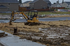 SPOTLIGHT PHOTO: COURTNEY VAUGHN - Equipment on the construction site of Dutch Canyon Estates in Scappoose preps a water-logged parcel Monday, March 13.