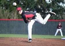 REVIEW/NEWS PHOTO: JIM BESEDA - Clackamas left-hander K.C. Reilly threw four shutout inning, checking La Salle Prep on one hit with one walk and six strikeouts in Thursday's 4-0 home win.