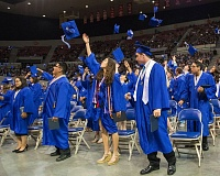 FILE PHOTO - Gresham High School 2016 graduates throw their caps in the air at graduation.