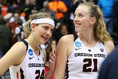 TRIBUNE PHOTO: JAIME VALDEZ - Moments after No. 2 seed Oregon State's one-point victory over No. 15 seed Long Beach State, Beavers Sydney Wiese (left) and Marie Gulich show their relief at Gill Coliseum on Friday.