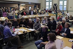PAMPLIN MEDIA GROUP: DAVID F. ASHTON - Hundreds of people pack the March Eastmoreland Neighborhood Association Board of Directors meeting, held in the Sellwood Middle School Library.