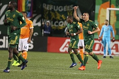 TRIBUNE PHOTO: JAIME VALDEZ - David Guzman (right) raises his fist after scoring the go-ahead goal Saturday night for the Portland Timbers, who beat the Houston Dynamo 4-2 at Providence Park.