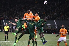 TRIBUNE PHOTO: JAIME VALDEZ - Portland Timbers players (from left) Zarek Valentin, Fanendo Adi and Lawrence Olum prevent Houston Dynamo forward Alberth Elis from scoring on a corner kick in the first half Saturday at Providence Park.