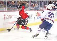 COURTESY: DAYNA FJORD/PORTLAND WINTERHAWKS - Portland Winterhawks forward Brad Ginnell keeps the puck from Spokane forward Rykr Cole on Sunday at Memorial Coliseum.
