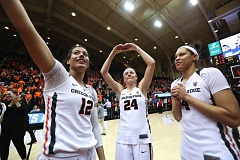 TRIBUNE PHOTO: JAIME VALDEZ - Oregon State players (from left) Kelbie Orum, Sydney Wiese and Breanna Brown acknowledge the crowd after Sunday's victory against Creighton.