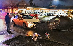 DAVID F. ASHTON - The driver of the Acura, the car on the right, drove away from his first hit-and-run smashup - but fled on foot after crashing the car a second time.