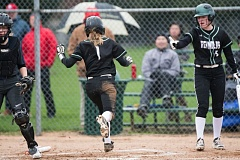 OUTLOOK PHOTO: JOSH KULLA - Reynolds sophomore Megan Convery scores Monday in the Raiders' 7-6 win over Lake Oswego in non-league prep softball action.