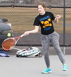 LON AUSTIN/CENTRAL OREGONIAN - Laura Fraser returns a ball during practice last week. Fraser and doubles partner Gwyneth Ptomey have qualified for the state tournament each of the last two seasons. The pair of seniors are two of the Cowgirls' most experienced players.