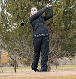 LON AUSTIN/CENTRAL OREGONIAN - Macy Goehring follows through after a tee shot during a recent practice at Meadow Lakes Golf Course. Goehring is one of two players returning off of last year's state tournament golf team.