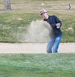 LON AUSTIN/CENTRAL OREGONIAN - Mayson Tibbs practices playing out of a bunker on the ninth hole at Meadow Lakes Golf Course. Tibbs, who finished third at last year's state championships, is expected to once again lead the Cowboys this year.