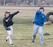 LON AUSTIN/CENTRAL OREGONIAN - Seniors Keenan Mozingo (left) and Kyle Smith throw the ball during warmups at a recent practice. Mozingo is expected to start in the outfield and pitch for the Cowboys, while Smith should be the team's first baseman. The two seniors are expected to be a major part of the Cowboys' success this coming season.