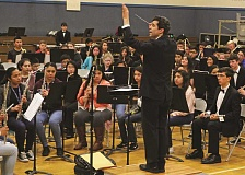 INDEPENDENT PHOTO: JULIA COMNES - Portland Youth Philharmonic conductor David Hattner leads a March 14 workshop with Valor Middle School students and members of PYP's Wind Ensemble.