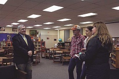 LINDSAY KEEFER - Russ Pickett (left), one of three finalists for the North Marion superintendent position, talks to community members in the middle school library on March 15.