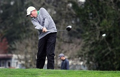 TIDINGS PHOTO: MILES VANCE - West Linn's Hunter Johnson tees off during the Three Rivers League tournament at Chehalem Glenn Golf Course on Monday in Newberg.