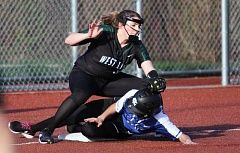 TIDINGS PHOTO: MILES VANCE - West Linn third baseman Lexi Grein tries to tag out Grant's Mia Ewell during the third inning of the Generals' 3-2 win at Rosemont Ridge Middle School on Tuesday.