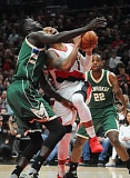 TRIBUNE PHOTO: JOSH KULLA - Trail Blazers guard Damian Lillard draws a foul inside against the Milwaukee Bucks.