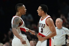 TRIBUNE PHOTO: JOSH KULLA - The Trail Blazers backcourt of Damian Lillard (left) and CJ McCollum had some things to shout about, but not at the end of Tuesday night's homecourt loss to the Milwaukee Bucks.