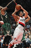 TRIBUNE PHOTO: JOSH KULLA - The Milwaukee Bucks defense tries to put the clamps on Trail Blazers guard CJ McCollum.