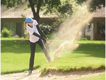 SPOKESMAN FILE PHOTO: COREY BUCHANAN - Wilsonville girls golfer Lexie Huebert hits out of a sand trap at a tournament last season.