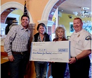 SUBMITTED PHOTO - Rotary members Martti Rahi, left, Tina Dickson and Meg Cummings present a check to JCEMS Assistant Chief Mike Lepin.