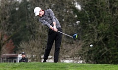 PAMPLIN MEDIA GROUP: MILES VANCE - Sherwood High School senior Carson Brinkley hits a drive during play Monday at the Three Rivers League tournament at Chehalem Glen.