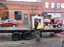 COURTESY OF CITY OF SHERWOOD - A monument sits on a flatbed truck after being removed from Old Town Sherwood on Feb. 17