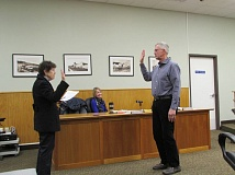 SPOTLIGHT PHOTO: COURTNEY VAUGHN - Columbia County Clerk Betty Huser (left) administers the oath of office to recently appointed Scappoose City Councilor Joel Haugen (right.) Haugen was appointed Monday to fill a vacant seat on the council.