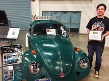 CONTRIBUTED - Peter Melton, a senior at Gresham High School, won $500 for the GHS auto program at the Portland Roadster Show with the work he is doing on his 1974 beetle.