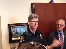 TRIBUNE FILE PHOTO - Portland Chief Mike Marshman is on leave while under investigation. He is shown flanked by former Mayor Charlie Hales last July when he was elevated to be Portland's top cop.