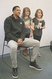 REVIEW/NEWS PHOTO: JIM BESEDA - Blazers guard C.J. McCollum posed for pictures with first-graders Cali Welches and Emma Powers during a visit to the Oak Grove Boys & Girls Club Wednesday.