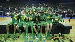 PHOTO COURTESY OF OREGON MEN'S BASKETBALL - Members of the University of Oregon men's basketball team celebrate their win over Kansas and a trip this weekend to the Final Four. The Ducks will face off against North Carolina on Saturday.