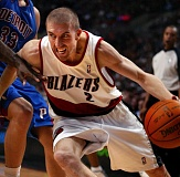 TRIBUNE FILE PHOTO: L.E. BASKOW - Steve Blake, charging to the basket in a November 2009 game, had three stints with the Trail Blazers and chose to raise his family here.