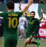 TRIBUNE PHOTO: JONATHAN HOUSE - Diego Valeri celebrates after giving the Portland Timbers a 1-0 lead Sunday night at Providence Park.