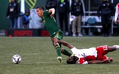 TRIBUNE PHOTO: JONATHAN HOUSE - David Guzman of the Portland Timbers tries to get to the ball against the New England Revolution on Sunday at Providence Park.