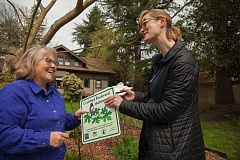 PHOTO BY GABRIEL OLSON - Lisa Batey, left, president of the Milwaukie City Council,  received certification in the Backyard Habitat Program on March 28, the first time the program has moved into Clackamas County. Handing her the certificate is Susie Peterson, Backyard Habitat Program manager for Columbia Land Trust.
