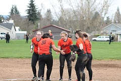 PIONEER PHOTO: CONNER WILLIAMS  - Molalla's infielders give each other encouragement after a play is made during the Indians' 13-12 win over Cascade on March 23 at Clark Park. Molalla has one non-league game left Tuesday at Valley Catholic before