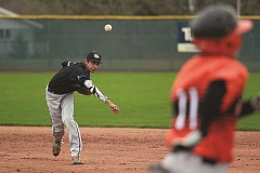 PHIL HAWKINS - Woodburn freshman Jose Ortiz throws out a Gladstone runner at first base on March 28 in the Bulldogs' 7-6 loss to the Gladiators in extra innings. Woodburn boasts plenty of talented athletes this season, though the team lacks experience.