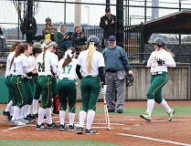 REVIEW/NEWS PHOTO: JIM BESEDA - Putnam players wait at home plate to greet Melia Croydon (right ) after her first-inning, two-run homer against Clackamas.