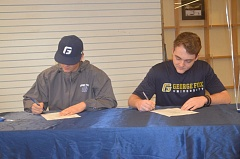 SPOKESMAN PHOTO: COREY BUCHANAN - Wilsonville senior baseball players Drake Carter (left) and Gage Gloster sign their letters of intent at Wilsonville High School.