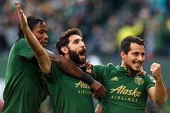 TRIBUNE PHOTO: JONATHAN HOUSE - Timbers (from left) Alvas Powell, Diego Valeri and Sebastian Blanco celebrate the Valeri volley that gave Portland a 1-0 lead Sunday against New England.