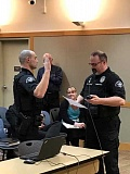 COURTESY OF CAPT. MARK DANIEL/SPD - Sherwood Police Chief Jeff Groth, right, swears in Colton Waker as the newest member of the Sherwood Police Department on April 4 as Connie Randall, the city's planning manager, looks on.