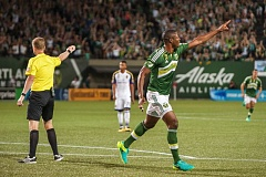 TRIBUNE FILE PHOTO - Fanendo Adi signals to the sidelines and crowd after scoring a goal for the Portland Timbers.