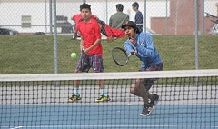 WILL DENNER/MADRAS PIONEER - The Madras doubles teams spelled trouble for many of their opponents last Saturday at MHS. The No. 2 doubles pairing of Rafael Giron-Patt (front) and Deon Culpus (back) won 28 games, putting them in second place thanks to a head-to-head tiebreaker.