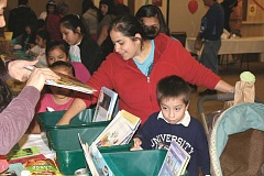 INDEPENDENT FILE PHOTO - Literacy is the main focus of Día del Niño/Day of the Child, so parents and children alike can look forward to a book giveaway at this year's event, scheduled for April 29 at Woodburn High School. Pictured are attendees of the 2014 event.