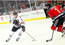 COURTESY: BRYAN HEIM/PORTLAND WINTERHAWKS - Portland Winterhawks defenseman Caleb Jones protects the puck from Rockets defenseman Lucas Johansen in Game 3 of the Western Conference semifinal series Tuesday against Kelowna at Memorial Coliseum.